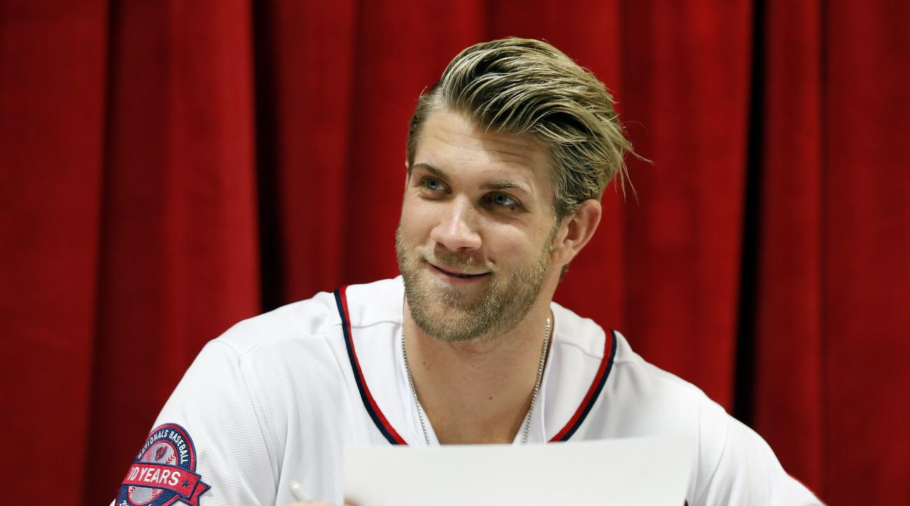 "Washington Nationals right fielder Bryce Harper smiles after he signs an autograph during the team's ""Winterfest"" baseball fan festival Saturday, Dec. 12, 2015, in Washington. (AP Photo/Alex Brandon)"