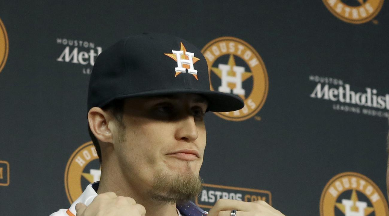 Former Philadelphia Phillies right-handed pitcher Ken Giles adjusts his new jersey as he is introduced as the newest addition to the Houston Astros Monday, Dec. 14, 2015, in Houston. The Astros traded four pitchers to the Phillies for Giles and shortstop