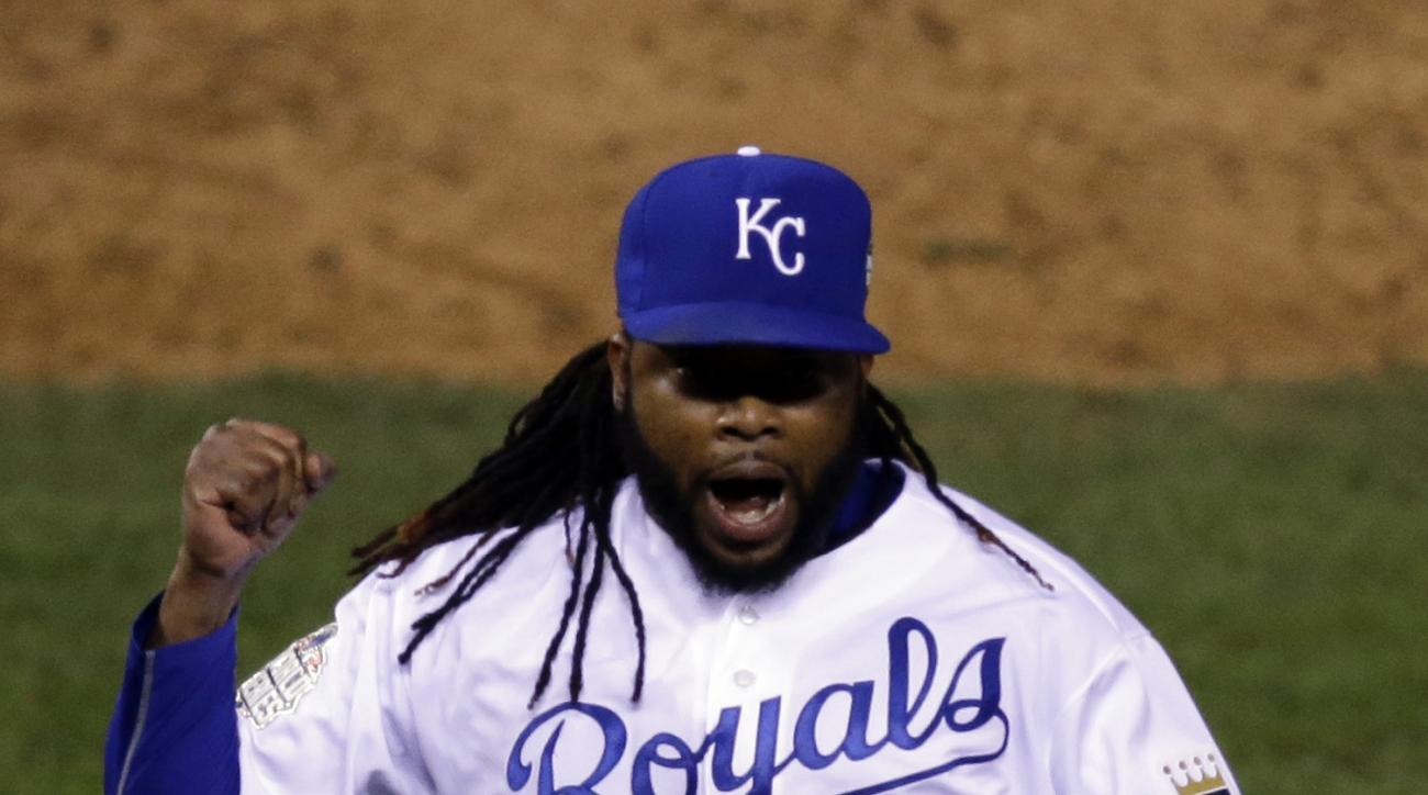 Kansas City Royals pitcher Johnny Cueto (47) celebrates the end of the top of the eighth inning of Game 2 of the Major League Baseball World Series against the New York Mets Wednesday, Oct. 28, 2015, in Kansas City, Mo.  (AP Photo/David Goldman)