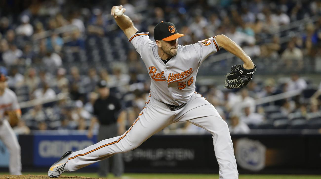 FILE - In this Sept. 9, 2015, file photo, Baltimore Orioles' Darren O'Day delivers a pitch during the eighth inning of a baseball game against the New York Yankees, in New York. All-Star reliever Darren O'Day and the Orioles have completed a $31 million,
