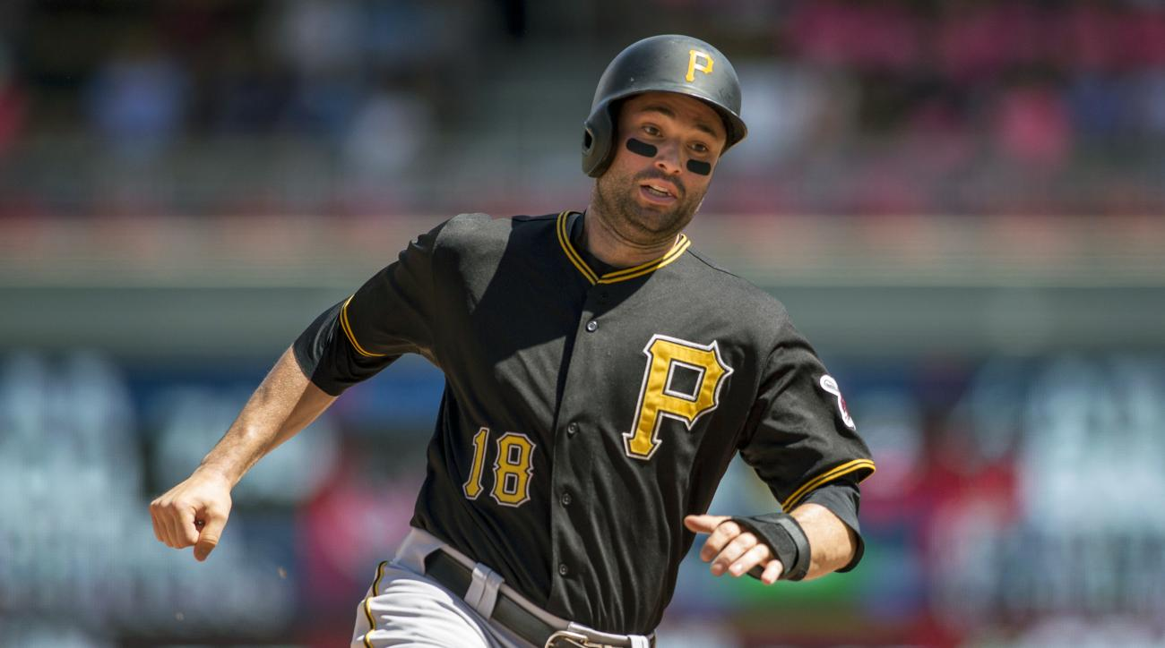 FILE - In this Wednesday, July 29, 2015 file photo, Pittsburgh Pirates second baseman Neil Walker (18) runs and scores against the Minnesota Twins in the ninth inning of a baseball game in Minneapolis. Even before playing his first game for the Mets, Neil