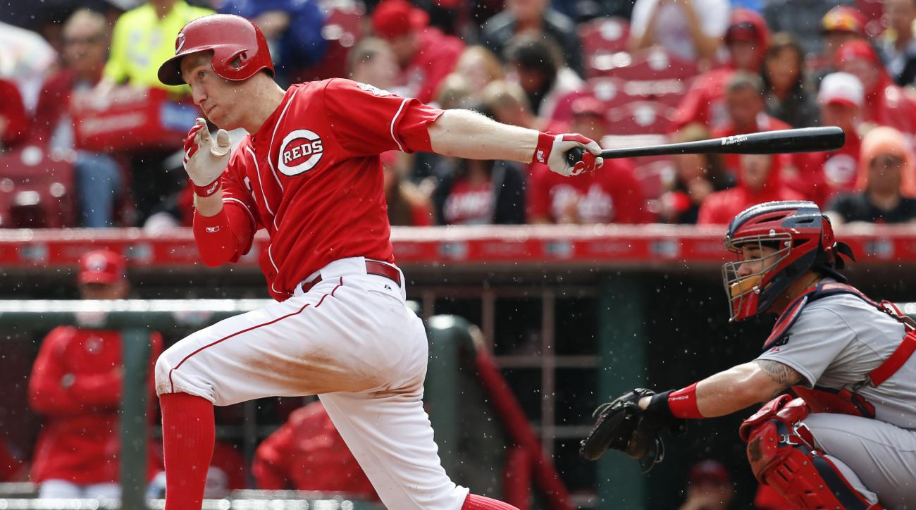 FILE - In this Sept. 12, 2015, file photo, Cincinnati Reds' Todd Frazier hits a single in the sixth inning of a baseball game against the St. Louis Cardinals, in Cincinnati. All-Star third baseman Todd Frazier has been dealt from the Reds to the Chicago W