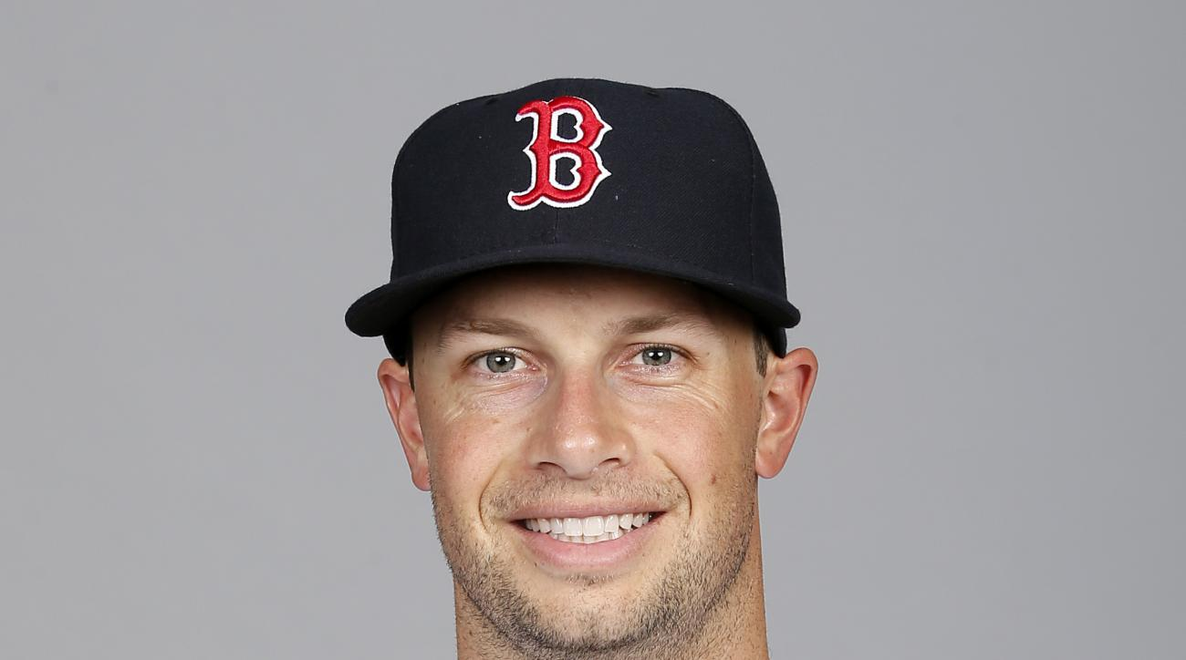 FILE - This is a 2015 file photo showing Daniel Nava of the Boston Red Sox baseball team. Outfielder Daniel Nava and the Los Angeles Angels have agreed to a one-year contract for a $1,375,000 salary. Nava's deal, announced Wednesday, Dec. 16, 2015,  is no