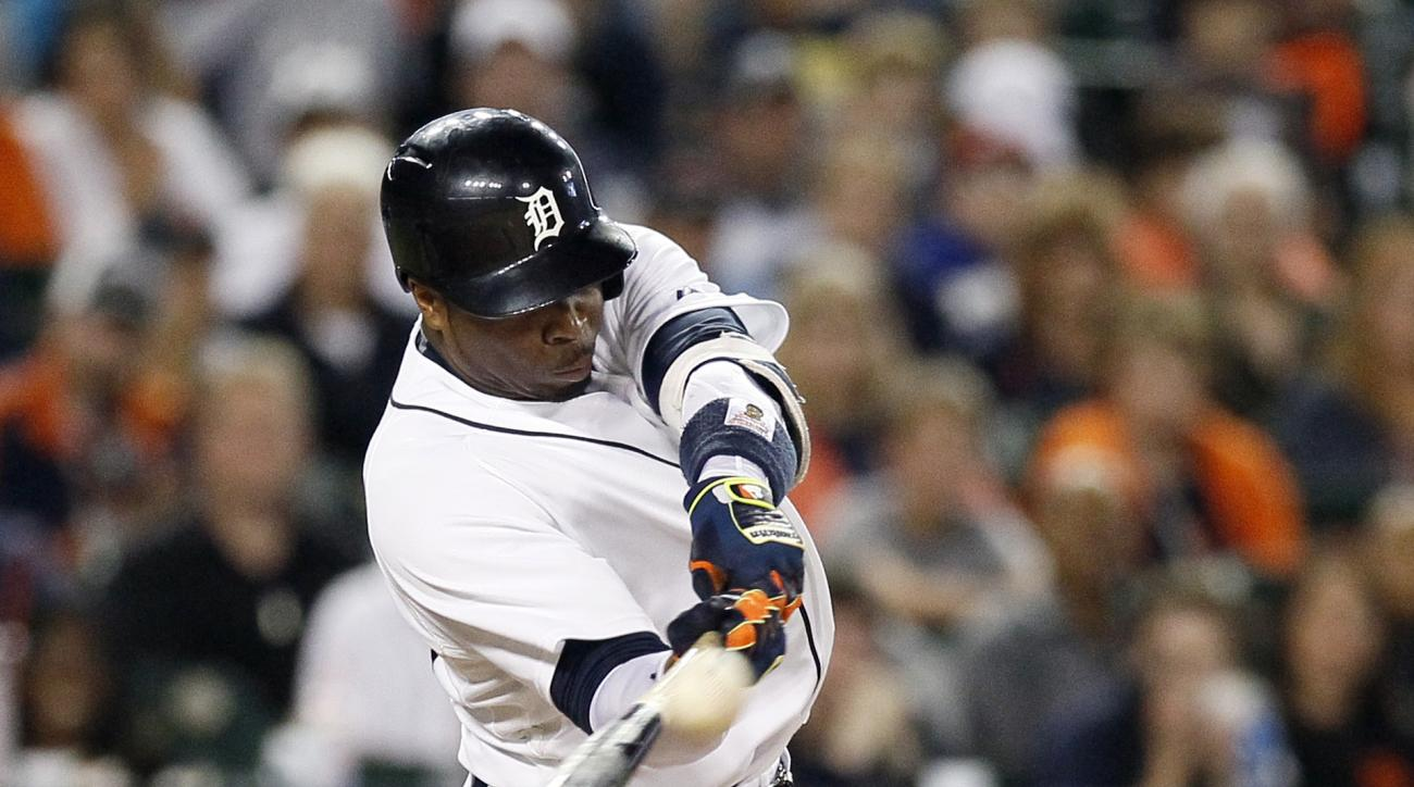 FILE - In this Sept. 25, 2015, file phoio, Detroit Tigers' Rajai Davis hits a two-run home run against the Detroit Tigers during the eighth inning of a baseball game against the Minnesota Twins at Comerica Park, in Detroit. Free agent outfielder Rajai Dav