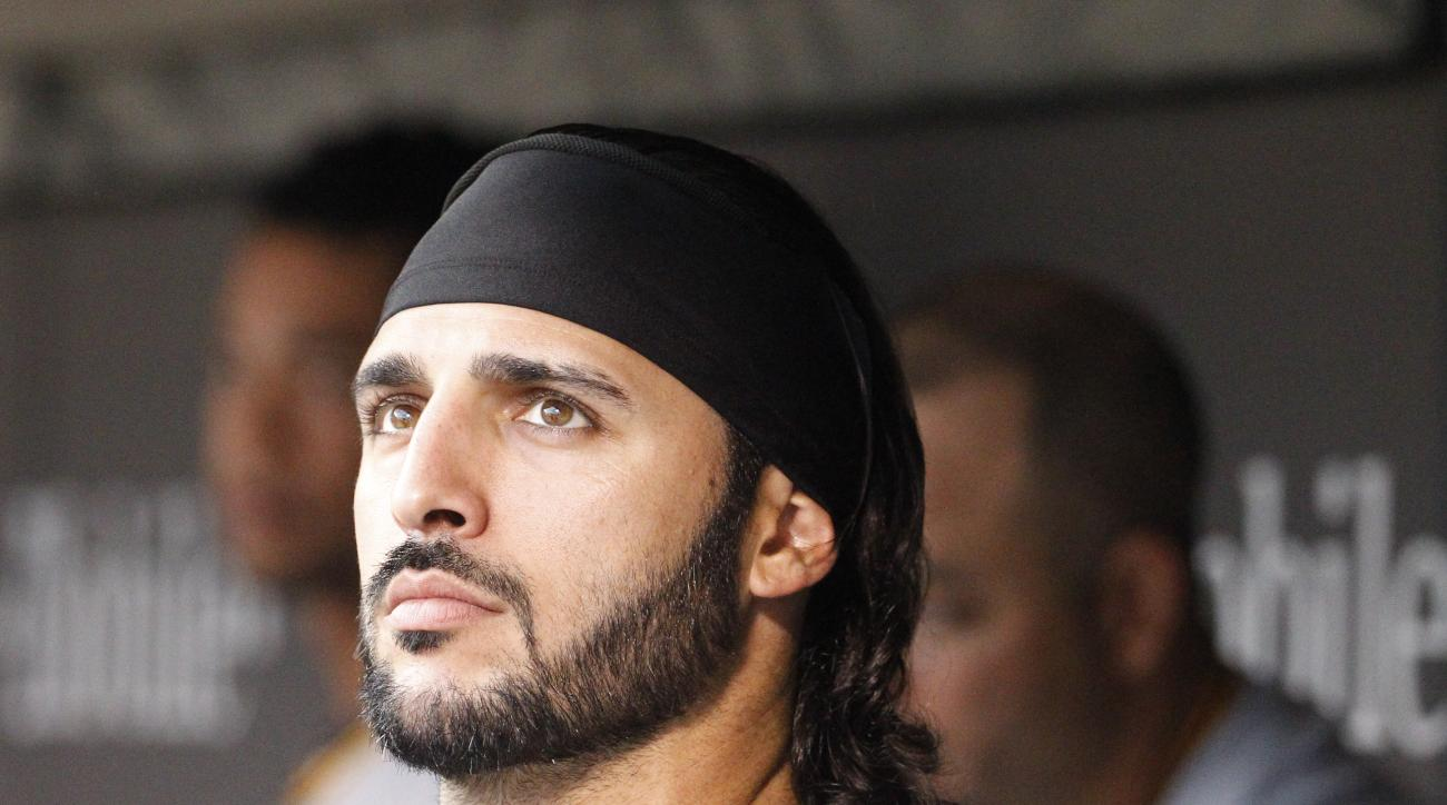Pittsburgh Pirates first baseman Sean Rodriguez looks out of the dugout before a baseball game against the Minnesota Twins in Minneapolis, Tuesday, July 28, 2015. (AP Photo/Ann Heisenfelt)