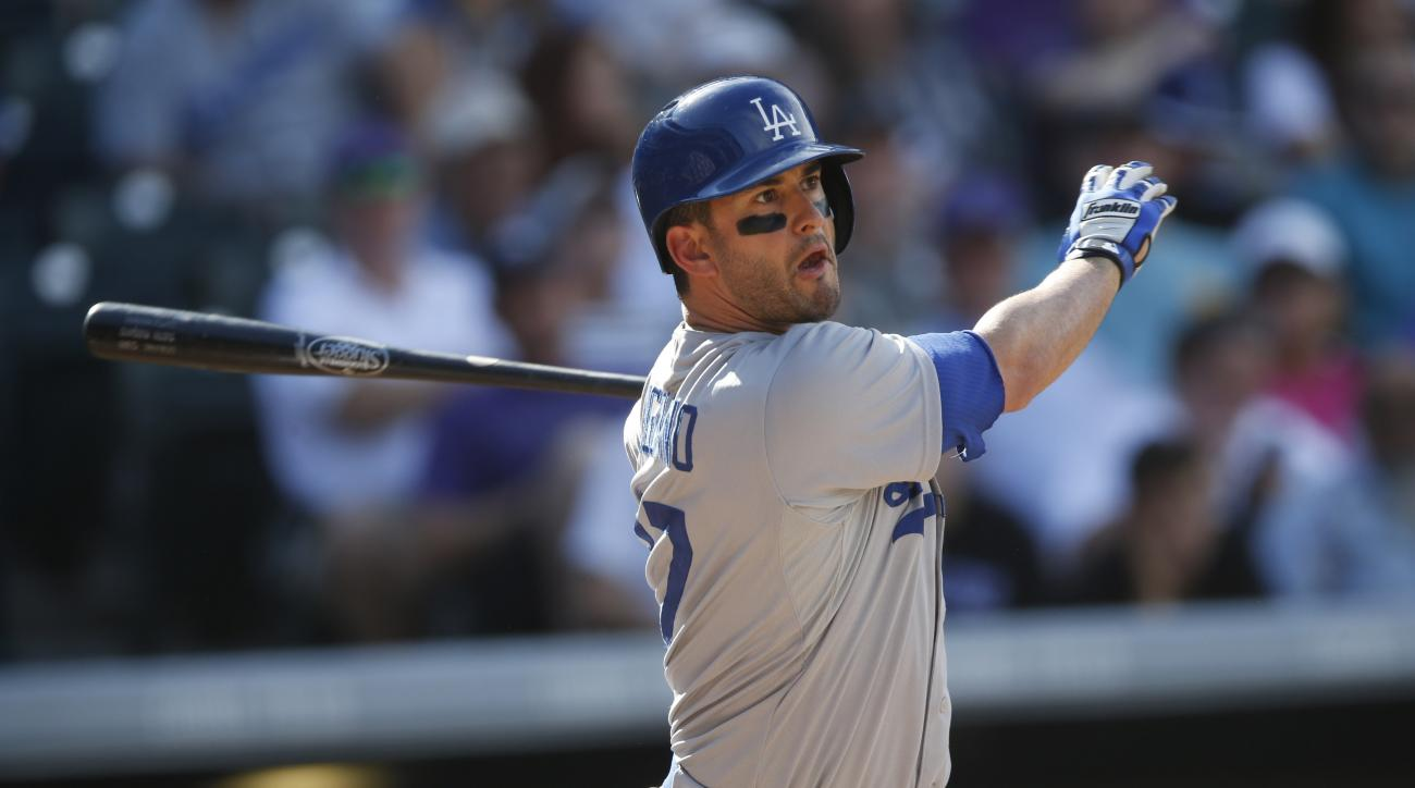 FILE - In this Sept. 27, 2015, file photo, Los Angeles Dodgers center fielder Justin Ruggiano (27) bats in the fourth inning of a baseball game, in Denver. Free-agent outfielder Justin Ruggiano has agreed to a $1.65 million, one-year contract with Texas,
