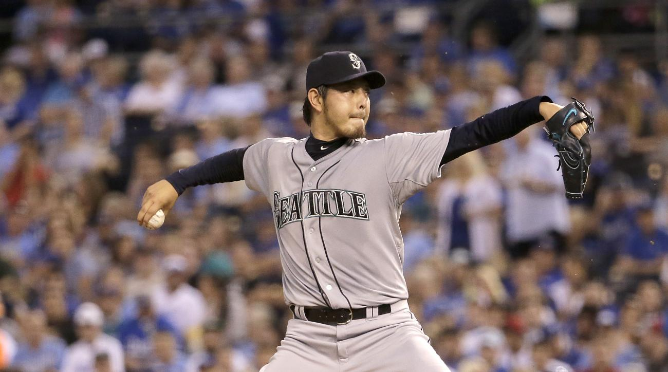 FILE - In this Sept. 22, 2015, file photo, Seattle Mariners starting pitcher Hisashi Iwakuma throws during the first inning of a baseball game against the Kansas City Royals, in Kansas City, Mo. he Seattle Mariners didn't wait long to go after Hisashi Iwa