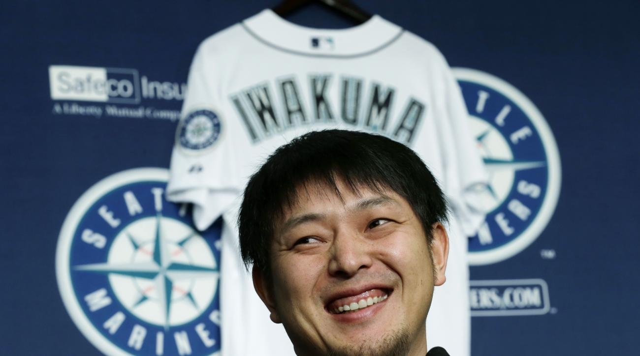 Seattle Mariners pitcher Hisashi Iwakuma smiles as he talks to reporters, Friday, Dec. 18, 2015, in Seattle. Iwakuma, who has been with the Mariners since 2012, signed a new one-year contract with the team for the 2016 season. (AP Photo/Ted S. Warren)