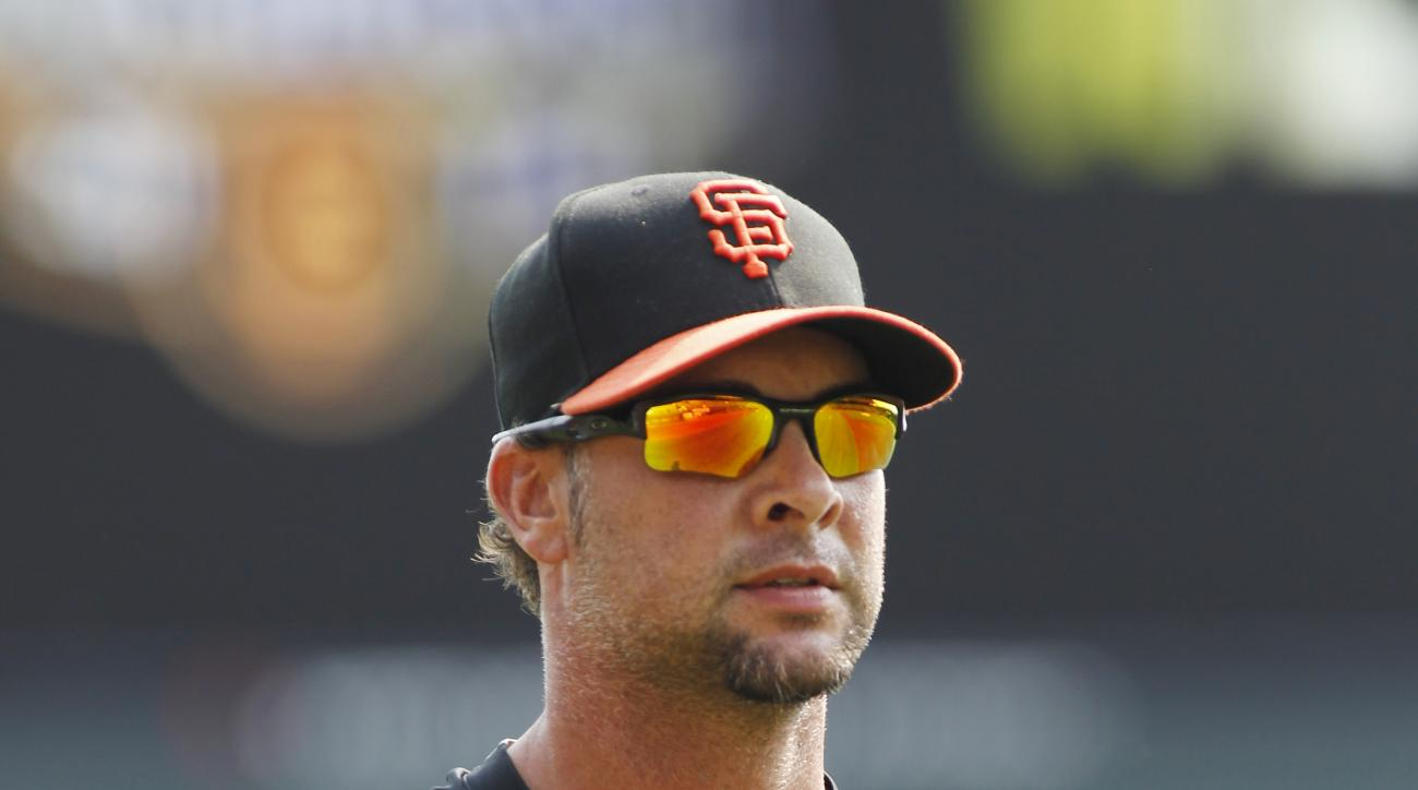 San Francisco Giants pitcher Ryan Vogelsong walks on the field before a baseball game against the San Diego Padres, Sunday, Sept. 13, 2015, in San Francisco. (AP Photo/George Nikitin)