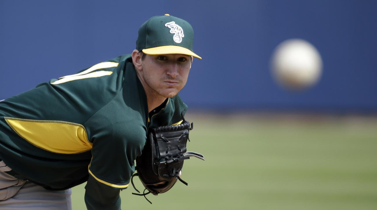 Oakland Athletics' Jarrod Parker throws before the first inning of an exhibition spring training baseball game against the Milwaukee Brewers Wednesday, March 5, 2014, in Phoenix. (AP Photo/Morry Gash)