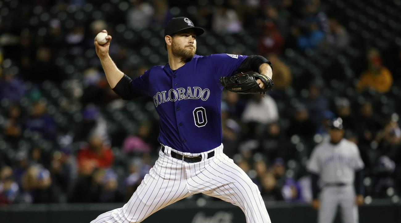 FILE - In this April 20, 2015 file photo, Colorado Rockies relief pitcher Adam Ottavino throws against the San Diego Padres during the eighth inning of a baseball game in Denver. A person with knowledge of the situation says the Colorado Rockies and right