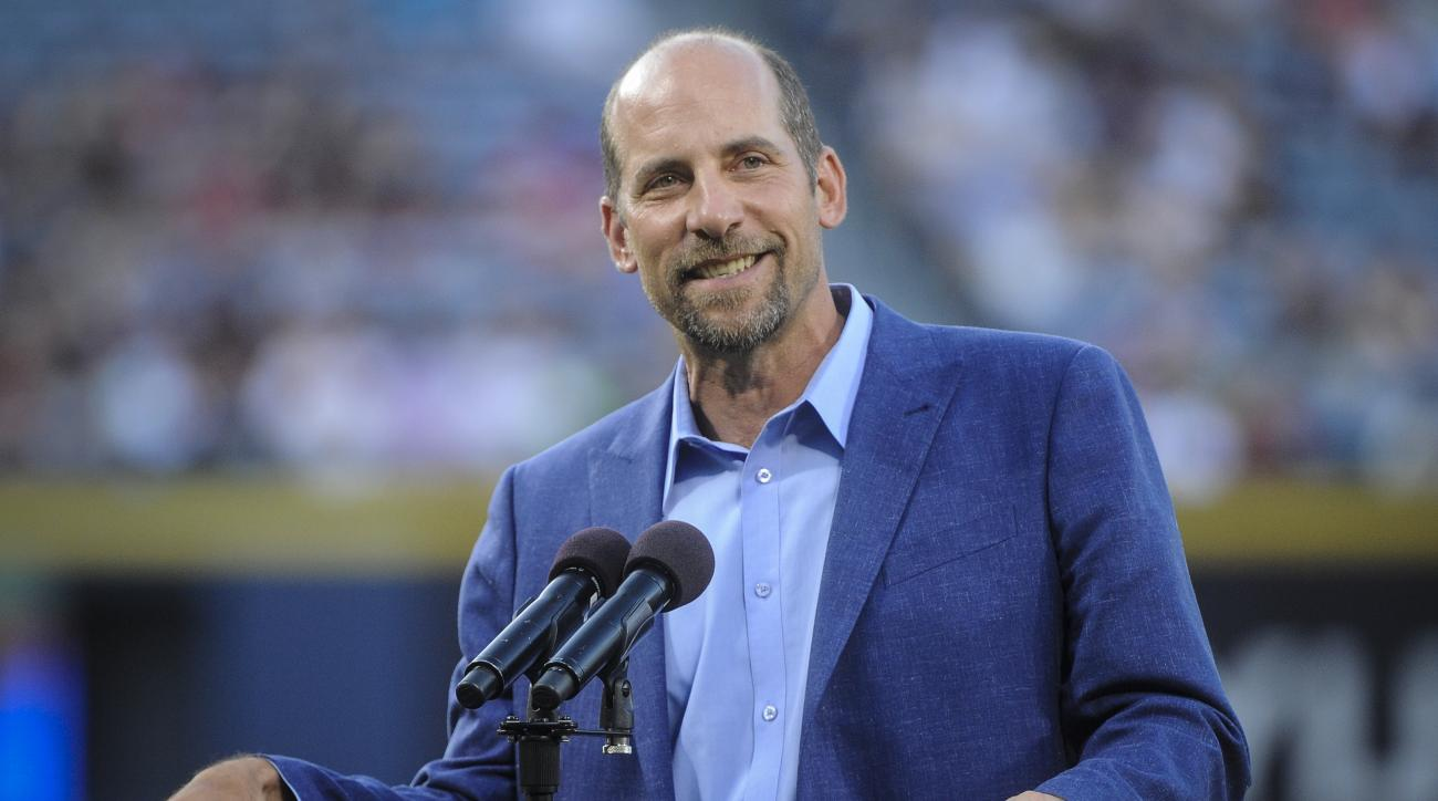 Former Atlanta Braves pitcher John Smoltz is honored for his induction into the Baseball Hall of Fame before the start of a baseball game against the Arizona Diamondbacks, Friday, August 14, 2015, in Atlanta. (AP Photo/John Amis)