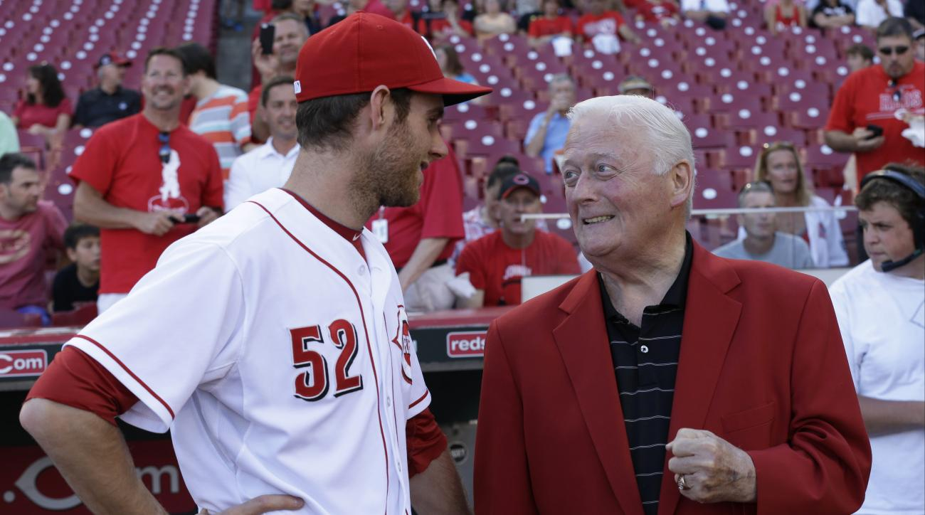 Cincinnati Reds starting pitcher Tony Cingrani (52) talks with former Reds pitcher Jim O'Toole prior to the start of a baseball game against the Philadelphia Phillies, Friday, June 6, 2014, in Cincinnati. (AP Photo/Al Behrman)