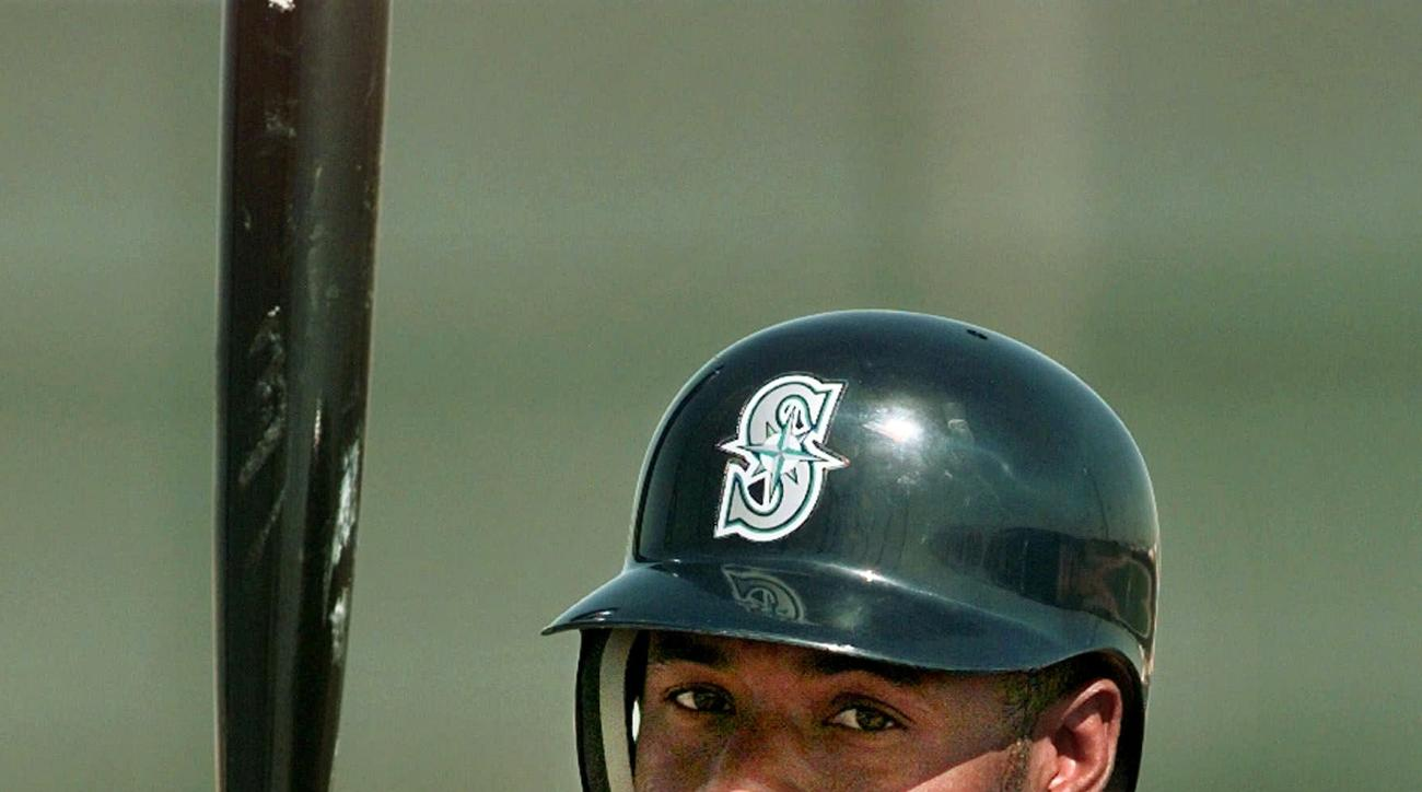 FILE - In this March 4, 1999, file photo, Seattle Mariners' Ken Griffey Jr. waits his turn to take batting practice during a baseball workout at spring training in Peoria, Ariz. The transcendent, once-in-a-generation athlete belonged to a little pocket of