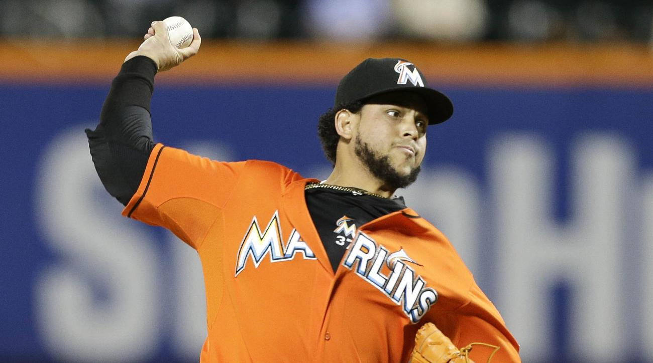 FILE - In this Wednesday, Sept. 17, 2014, file photo, Miami Marlins' Henderson Alvarez delivers a pitch during the first inning of a baseball game against the New York Mets in New York. Alvarez can earn $1.6 million in performance bonuses based on starts