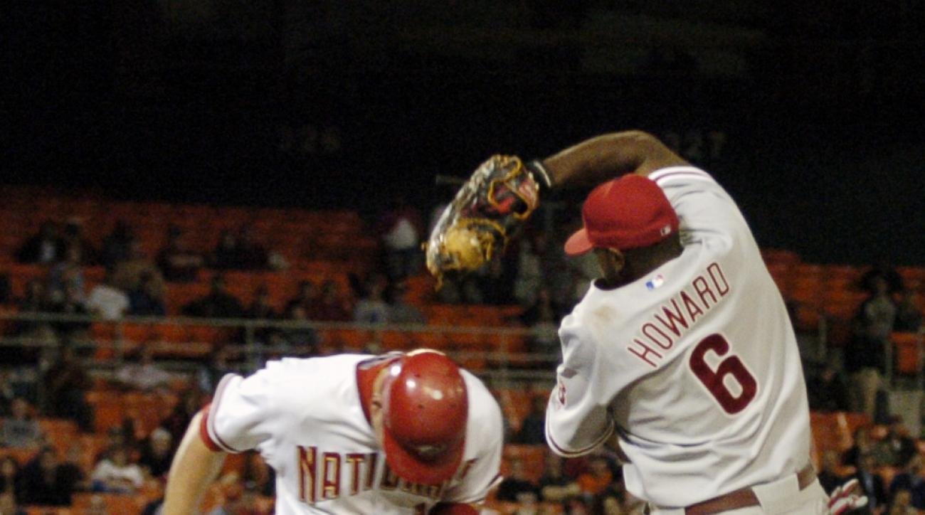 Washington Nationals' Ryan Zimmerman, left, is ruled safe at first as Philadelphia Phillies first baseman Ryan Howard tries to make the play on a throw from shortstop Jimmy Rollins during the eighth inning of a baseball game Wednesday, Sept. 27, 2006, in