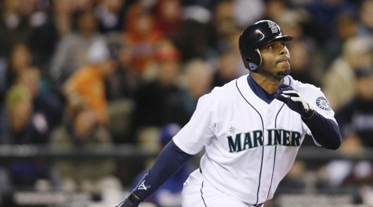 FILE - This is an Oct. 3, 2009, file photo showing Seattle Mariners' Ken Griffey Jr. hitting a solo home run on a pitch from Texas Rangers' Tommy Hunter during the fourth inning of a baseball game in Seattle.  Ken Griffey Jr. seems assured of election to