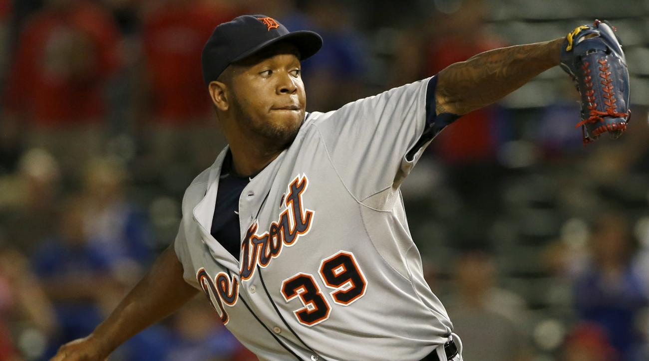 Detroit Tigers relief pitcher Neftali Feliz (39) throws against the Texas Rangers during a baseball game Monday Sept. 28, 2015, in Arlington, Texas. (AP Photo/Ron Jenkins)