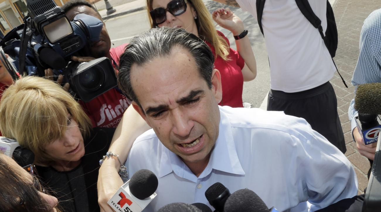 FILE - In this Tuesday, Feb. 17, 2015 file photo, Anthony Bosch talks to reporters as he prepares to turn himself in at federal court in Miami. Federal prosecutors want a Miami judge to reduce by more than a year the prison sentence being served by Bosch,
