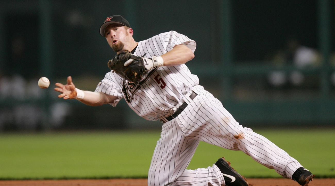 FILE - In this Aug. 5, 2004 file photo, Houston Astros first baseman Jeff Bagwell throws to first base from his knees after fielding a hit by Atlanta Braves'  Rafael Furcal during the third inning in Houston. Jeff Bagwell, Tim Raines fell just short of el