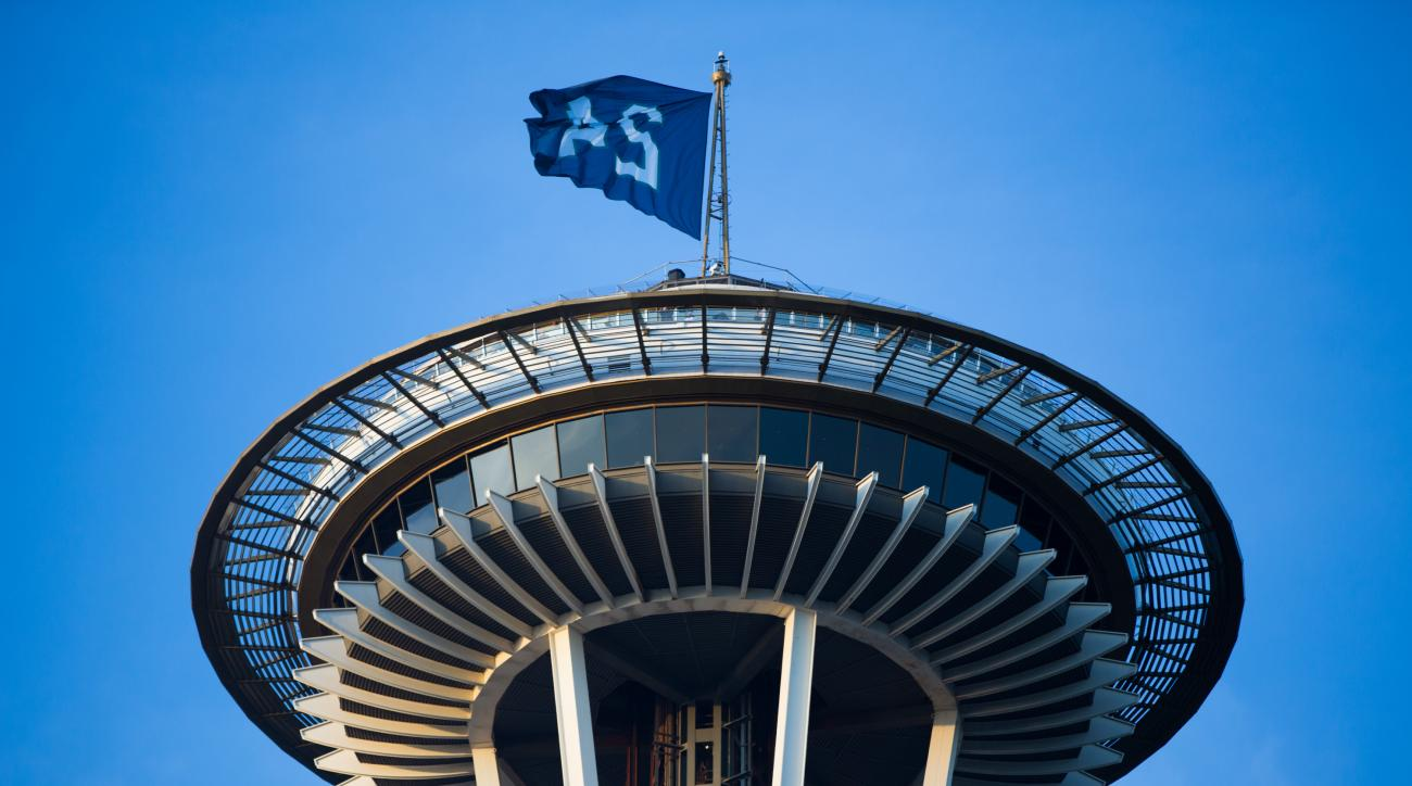 A Ken Griffey Jr. flag waves from the Space Needle in honor of Griffey's election to the Baseball Hall of Fame, Wednesday, Jan. 6, 2016, in Seattle. (Grant Hindsley/Seattlepi.com via AP)