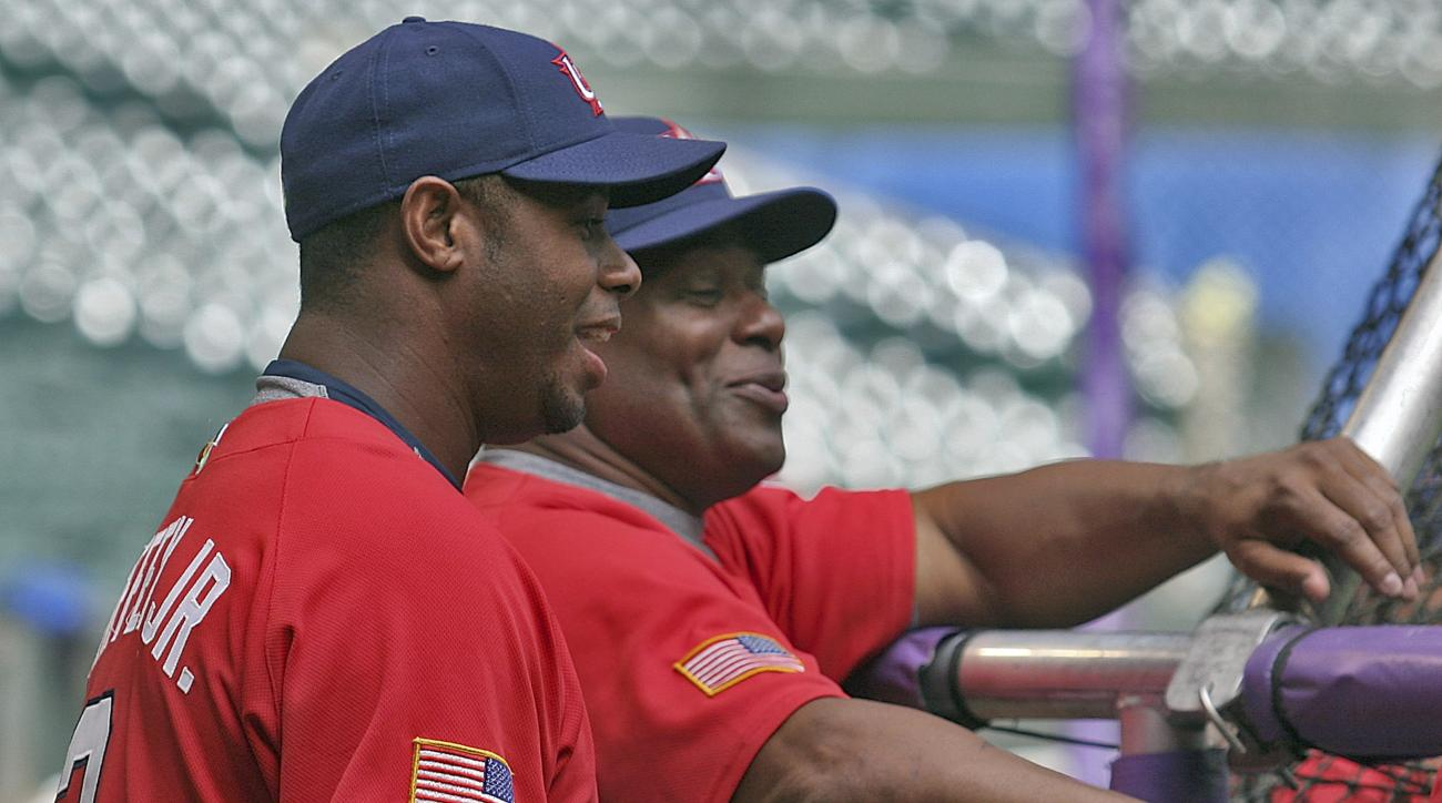 FILE - In this Monday March 6, 2006 file photo, Team USA outfielder Ken Griffey, Jr., left and coach Ken Griffey, Sr., right, share a laugh during batting practice at Chase Field in Phoenix. Ken Griffey Sr. said the family was hoping to get the call on hi