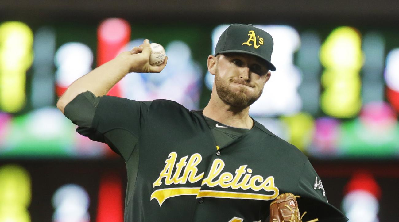 FILE - In this Tuesday, Sept. 10, 2013 file photo, Oakland Athletics pitcher Ryan Cook pitches against the Minnesota Twins in the eighth inning of a baseball game in Minneapolis. Right-hander Ryan Cook has agreed to a one-year contract with the Seattle Ma