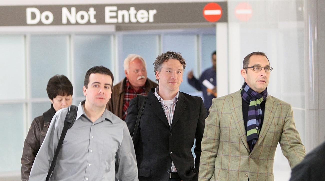 In this Dec. 8, 2011, photo, then-St. Louis Cardinals scouting director Christopher Correa, left, assistant general manager Mike Girsch, center, and general manager John Mozeliak, right, arrive  at Lambert-St. Louis International Airport in St. Louis, Mo.