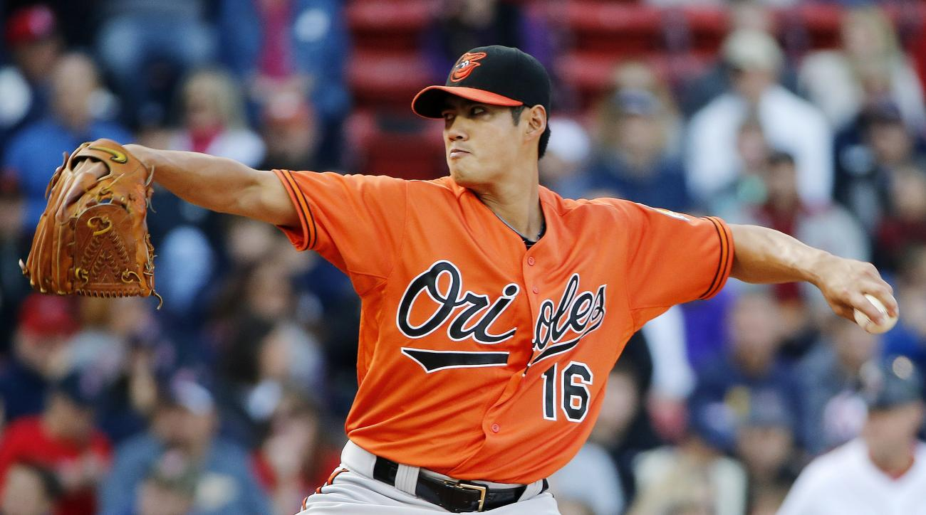 Baltimore Orioles' Wei-Yin Chen pitches during the first inning of a baseball game against the Boston Red Sox in Boston, Saturday, Sept. 26, 2015. (AP Photo/Michael Dwyer)