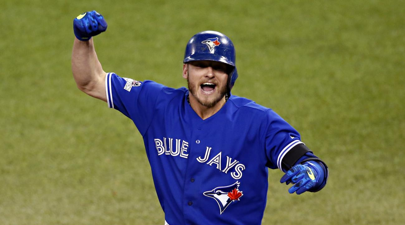 FILE- In this Oct. 19, 2015, file photo, Toronto Blue Jays' Josh Donaldson celebrates his two run home run against the Kansas City Royals during the third inning in Game 3 of baseball's American League Championship Series in Toronto. Cy Young Award winner