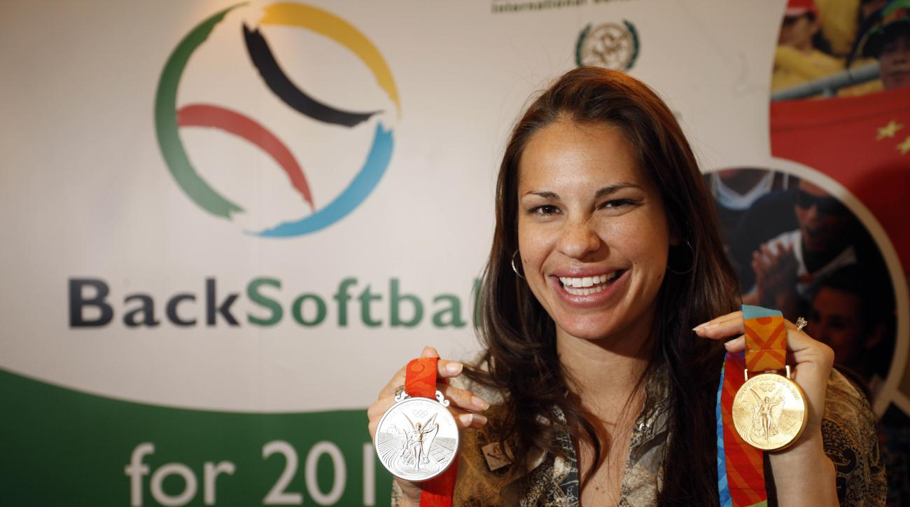 "FILE - This March 25, 2009 file photo shows Olympic softball medalist Jessica Mendoza, of the United States, smiling during the 2009 SportAccord gathering in Denver. Mendoza will stay permanently on ""Sunday Night Baseball"" in a groundbreaking assignment f"