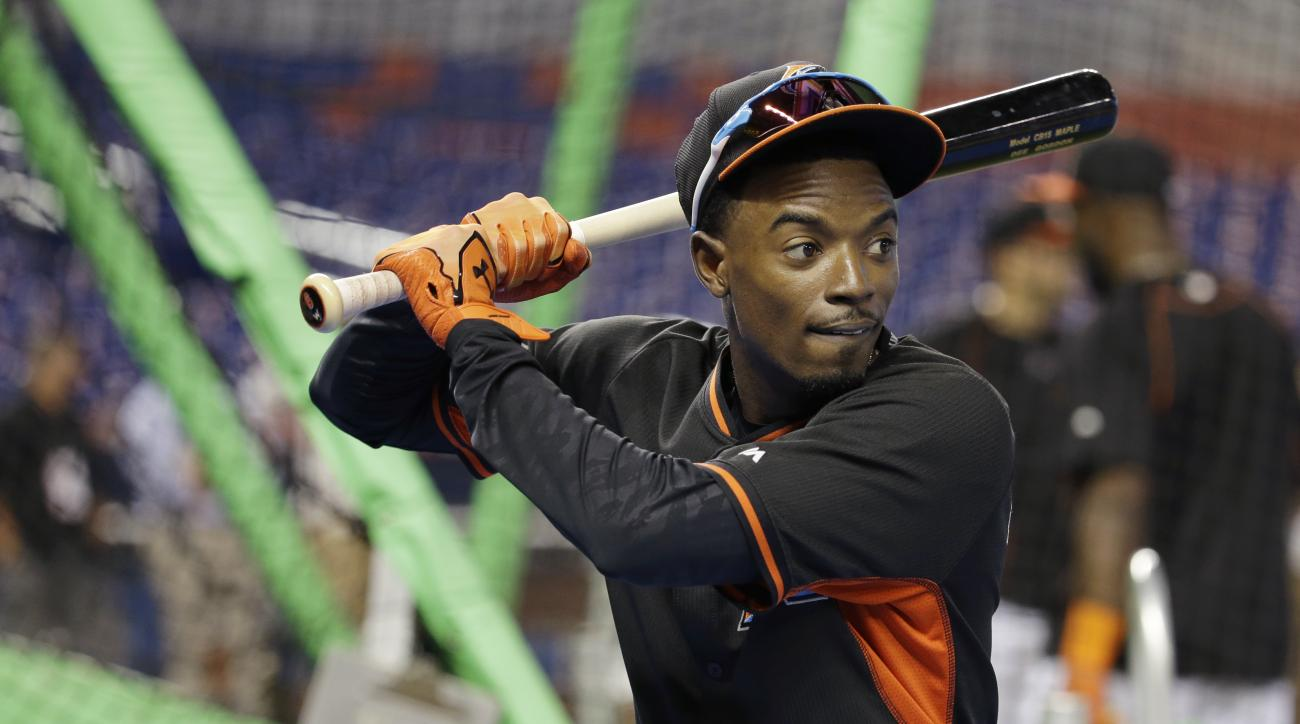 Miami Marlins second baseman Dee Gordon waits to bat during batting practice before a baseball game against the Atlanta Braves, Friday, Sept. 25, 2015, in Miami. (AP Photo/Lynne Sladky)