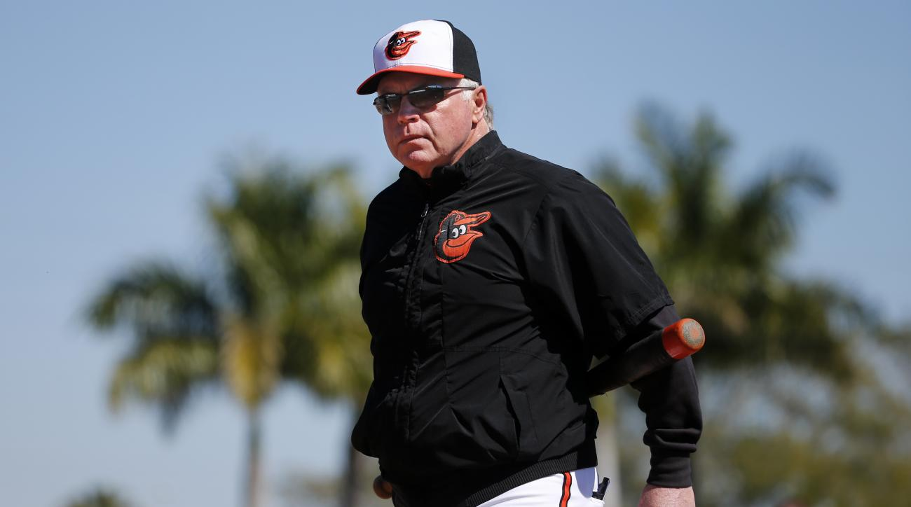 FILE - In this Feb. 20, 2015, file photo, Baltimore Orioles manager Buck Showalter watches the first day of spring training baseball for Orioles pitchers and catchers,  in Sarasota, Fla. Spring training is only a month away, yet the Orioles' offseason rem