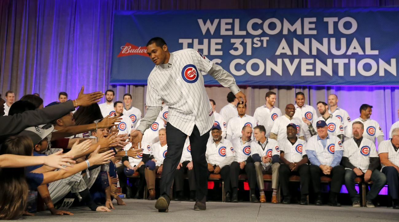 Chicago Cubs second baseman Addison Russell is greeted by fans after being introduced at the team's annual baseball convention Friday, Jan. 15, 2016, in Chicago. (AP Photo/Charles Rex Arbogast)