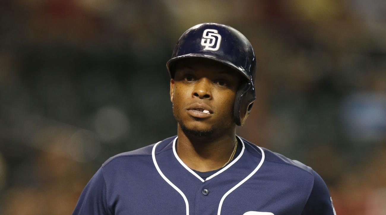 San Diego Padres' Justin Upton crosses home plate after hitting a solo home run against the Arizona Diamondbacks in the first inning of a baseball game, Tuesday, Sept. 15, 2015, in Phoenix. (AP Photo/Rick Scuteri)
