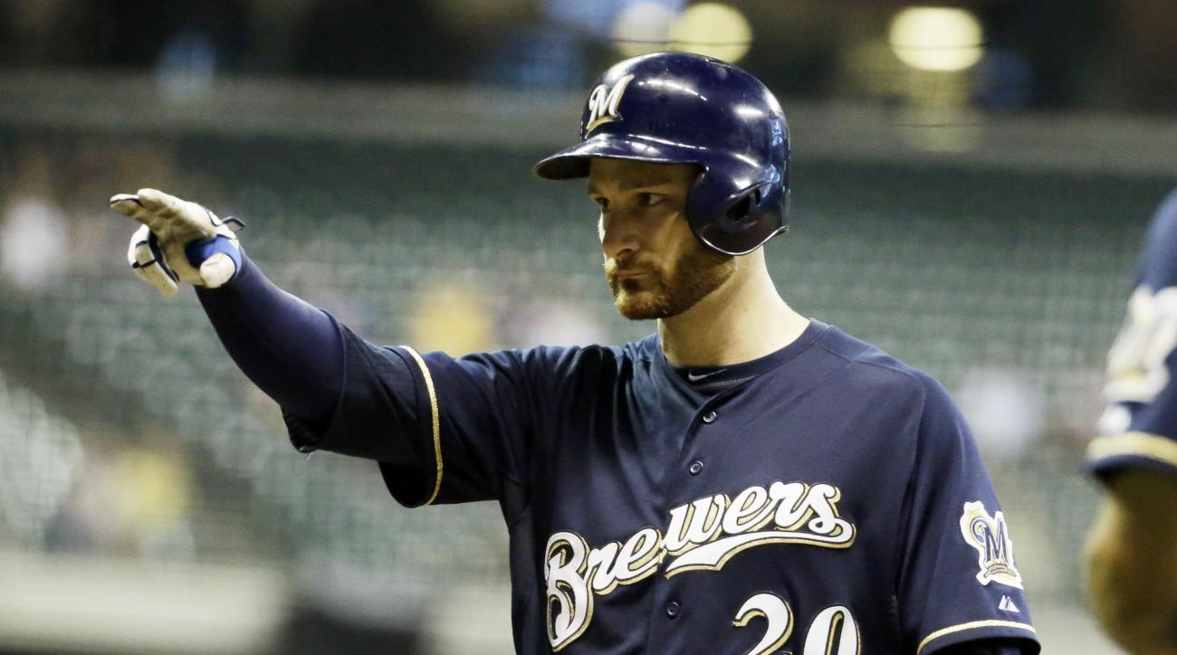 Milwaukee Brewers' Jonathan Lucroy reacts after hitting a two-run scoring single during the fourth inning of a baseball game against the Pittsburgh Pirates Wednesday, Sept. 2, 2015, in Milwaukee. (AP Photo/Morry Gash)