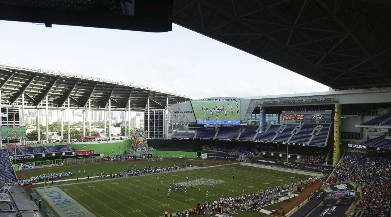Western Kentucky and South Florida play during the second half of the NCAA college football Miami Beach Bowl game at Marlins Park, Monday, Dec. 21, 2015, in Miami. (AP Photo/Lynne Sladky)