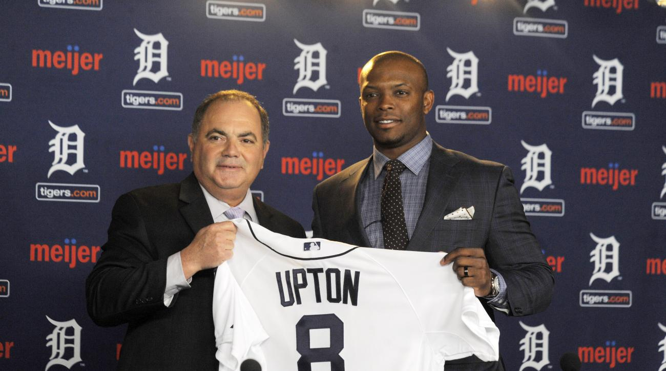 In this Jan. 20, 2016, photo, Detroit Tigers gewneral manager Al Avila,  left, poses with new Tigers outfielder Justin Upton after announcing a six-year contract at Comerica Park in Detroit, Mich. (Steve Perez/Detroit News via AP)  DETROIT FREE PRESS OUT;