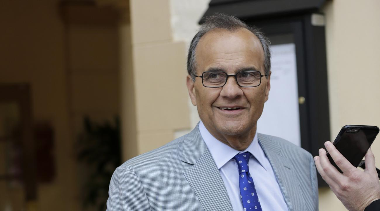 Major League Baseball Chief Baseball Officer, Joe Torre, is interviewed as he leaves a meeting of MLB owners, Thursday, Jan. 21, 2016, in Coral Gables, Fla. Owners held their last meeting before the likely start of collective bargaining, where revenue sha