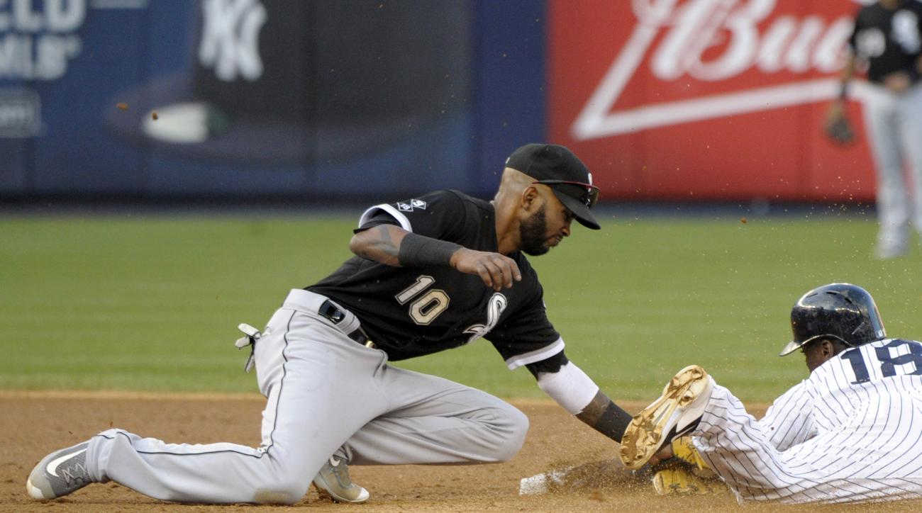 FILE - In this Sept. 26, 2015, file photo, Chicago White Sox shortstop Alexei Ramirez, left, tags out New York Yankees' Didi Gregorius who was attempting to steal second base during the fifth inning of a baseball game in New York. Ramirez and the San Dieg