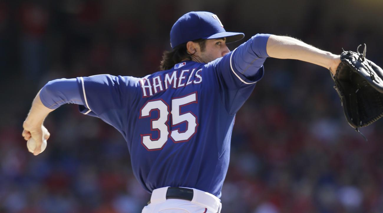 FILE - In this Oct. 4, 2015, file photo, Texas Rangers starting pitcher Cole Hamels throws during a baseball game against the Los Angeles Angels in Arlington, Texas. Hamels is under contract with the Rangers for at least three more seasons. And he is star