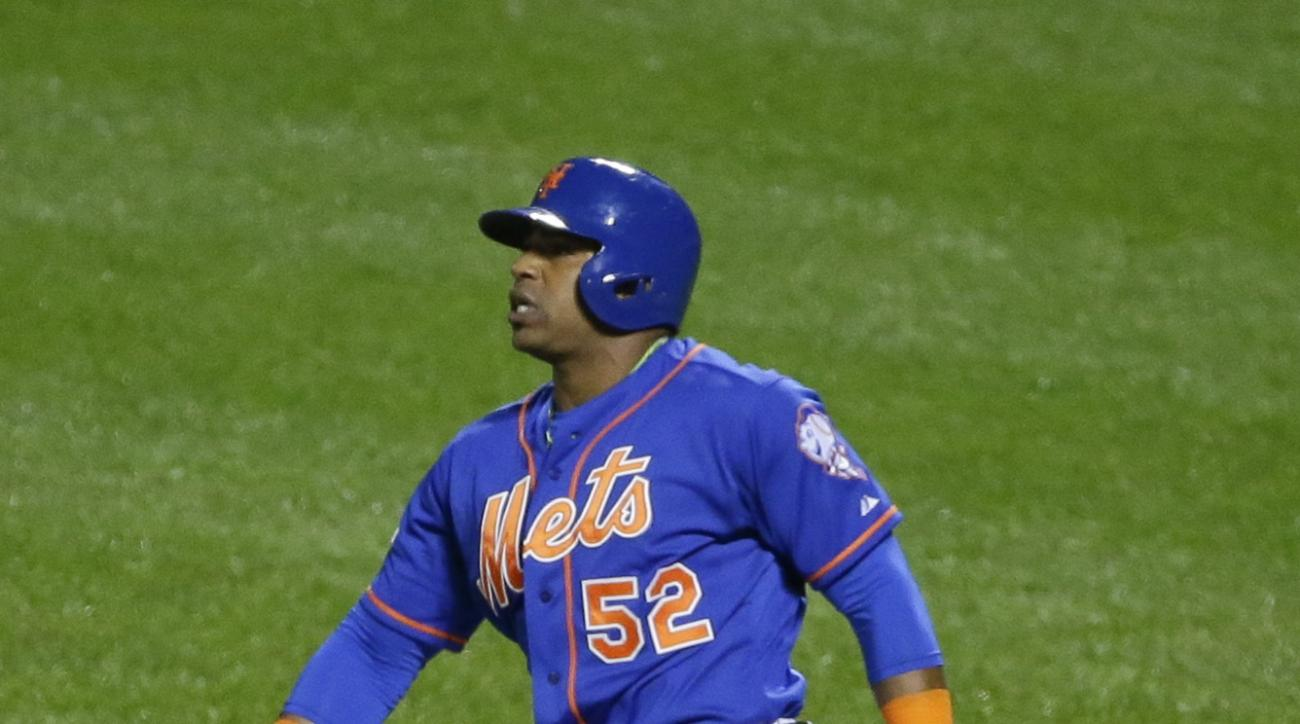 New York Mets center fielder Yoenis Cespedes (52) follows through on an three run home run during the fourth inning in Game 3 of baseball's National League Division Series against the Los Angeles Dodgers, Monday, Oct. 12, 2015, at CitiField in New York.
