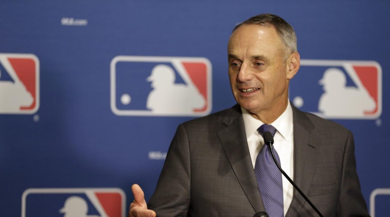 FILE - In this Jan. 21, 2016, file photo, Major League Baseball commissioner Rob Manfred speaks during a news c