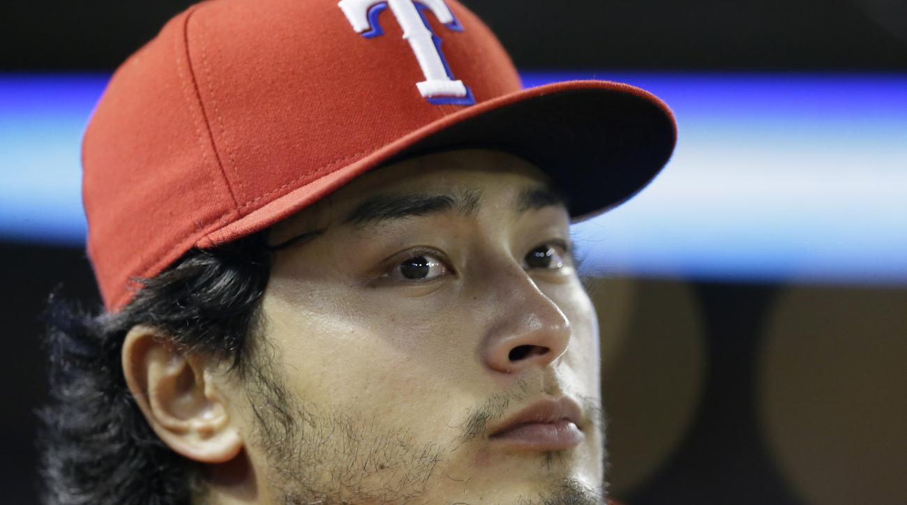 Texas Rangers pitcher Yu Darvish of Japan watches from the dugout during a baseball game against the Seattle Mariners in Arlington, Texas, Saturday, Sept. 19, 2015. (AP Photo/LM Otero)