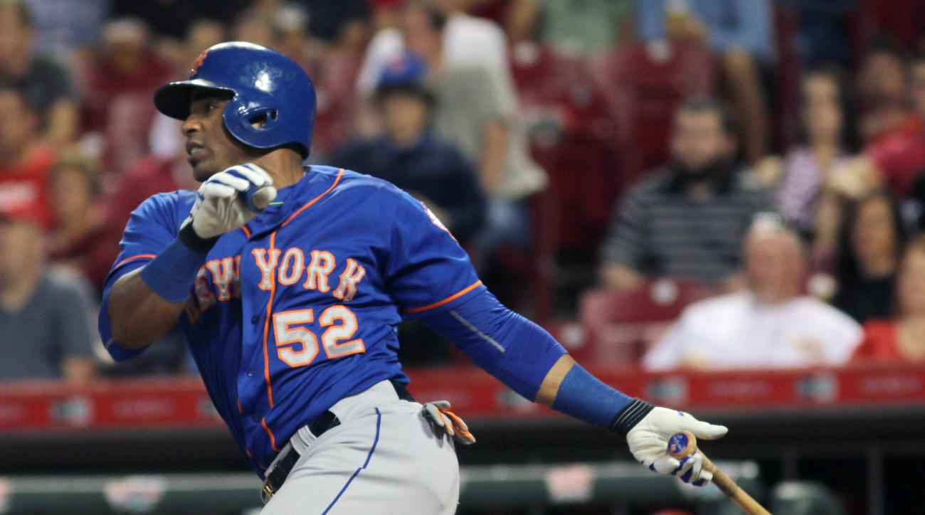 FILe - In this Sept. 24, 2015, file photo, New York Mets' Yoenis Cespedes hits an RBI single against the Cincinnati Reds in the seventh inning of a baseball game in Cincinnati. Cespedes is back with the New York Mets to beef up their offense  for one full