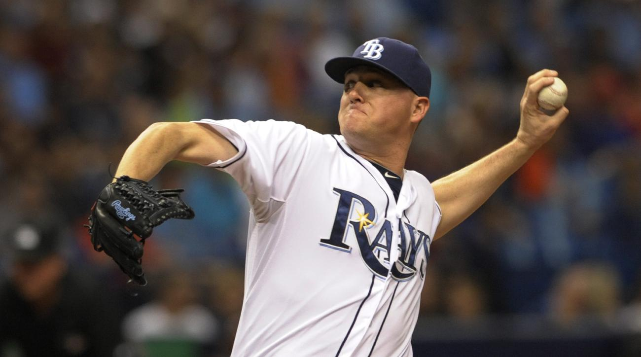 This July 11, 2015 photo shows Tampa Bay Rays reliever Jake McGee pitching against the Houston Astros during a baseball game in St. Petersburg, Fla. A person with knowledge of the situation says the Tampa Bay Rays have agreed to acquire outfielder Corey D