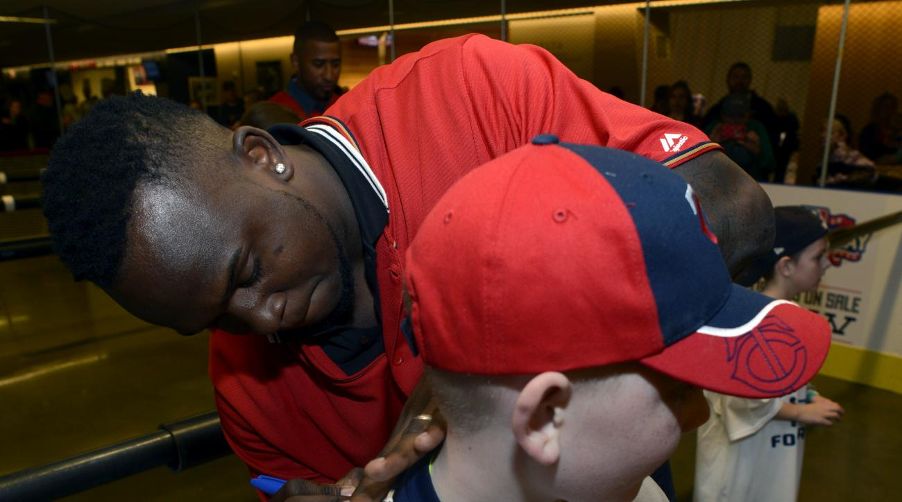 Minnesota Twins' Miguel Sano signs an autograph during TwinsFest, Friday, Jan. 29, 2016, in Minneapolis. (AP Photo/Hannah Foslien)