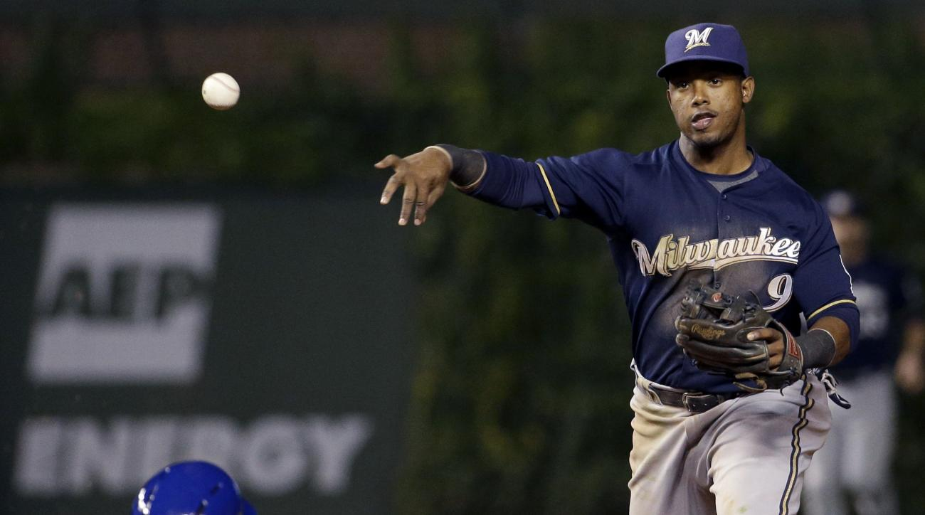 FILE - In this Sept. 23, 2015, file photo, Milwaukee Brewers shortstop Jean Segura, right, throws out Chicago Cubs' Chris Coghlan at first base after forcing out Tommy La Stella, left, during the eighth inning of a baseball game in Chicago. The Arizona Di