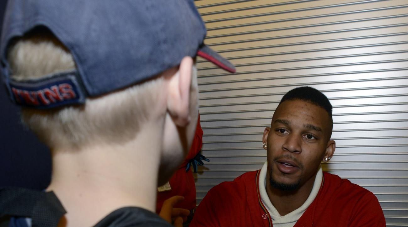 In this Friday, Jan. 29, 2016 photo, Minnesota Twins' Byron Buxton signs an autograph during TwinsFest in Minneapolis. Buxton relished his time on the annual winter caravan with the Twins. The Twins took Buxton with the No. 2 overall pick in the 2012 draf
