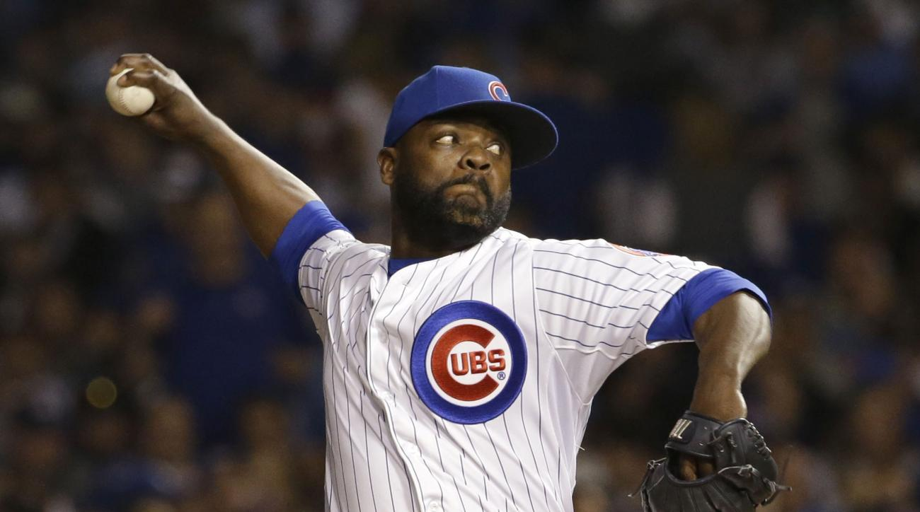 FILE - In this Wednesday, Oct. 21, 2015 file photo, Chicago Cubs pitcher Fernando Rodney throws during the eighth inning of Game 4 of the National League baseball championship series against the New York Mets in Chicago. Reliever Fernando Rodney and the S